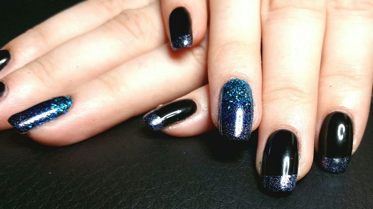 Black shellac with navy glitter tips and ombre glitter detail