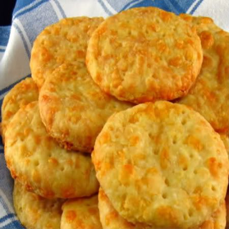 Australian Busters Recipe (One Perfect Bite) | Busters are savory biscuits or crackers that were given this unusual name because when eaten without caution they become belt busters. They are made from a cheesy dough that is very much like the dough used to make a pie.