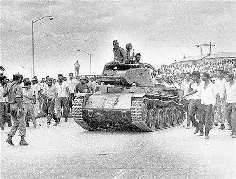 Rebels at the Duarte bridge with a capture Sweden made L-60 light tank