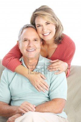 Happy seniors couple in love. Healthy teeth. Isolated over white background   Stock Photo