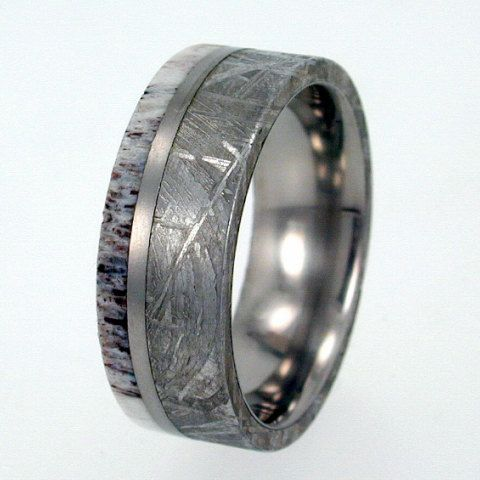 Meteorite Ring / Antler Ring / Gibeon Meteorite and Deer Antler inlaid on Titanium with Titanium pinstripe. $576.00, via Etsy.