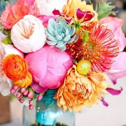 Pink and orange flowers in blue jar - could do mason jars for centerpieces