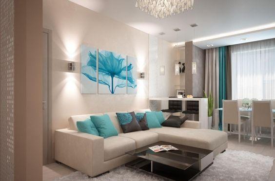 canapé d'angle blanc neige, table basse noir laqué, coussins décoratifs bleu ciel et tableau multicolore
