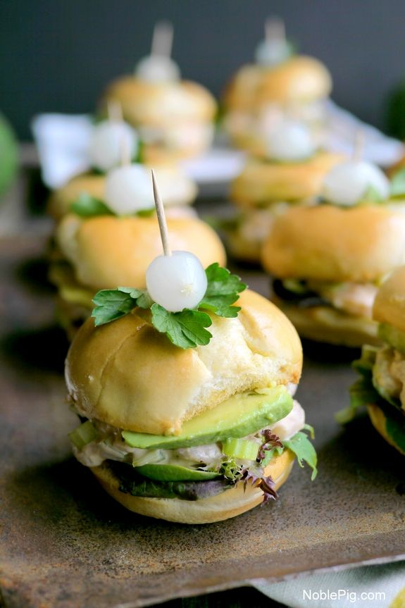 Avocado and Bay Shrimp Sliders with Spicy Mayo from NoblePig.com. This is a luncheon favorite everyone will love. Perfect for backyard entertaining, showers and Sunday brunch.