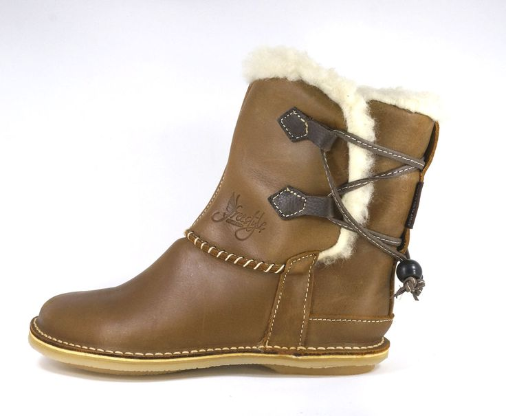 Freestyle (Crazyhorse Mocca) NEW Annabelle Handmade Genuine Full Grain Leather.  Pure Wool-Lined Half boot with Leather Thong Strapping Detail. R 1'489.  Handcrafted in Cape Town, South Africa. Code: 309101  NEW.  See online shopping for sizes. Shop for Freestyle online https://www.thewhatnotshoes.co.za Free delivery within South Africa.