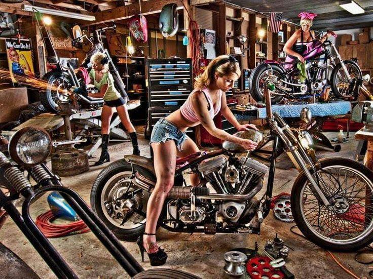 Harley Davidson shop garage. Mechanics at work
