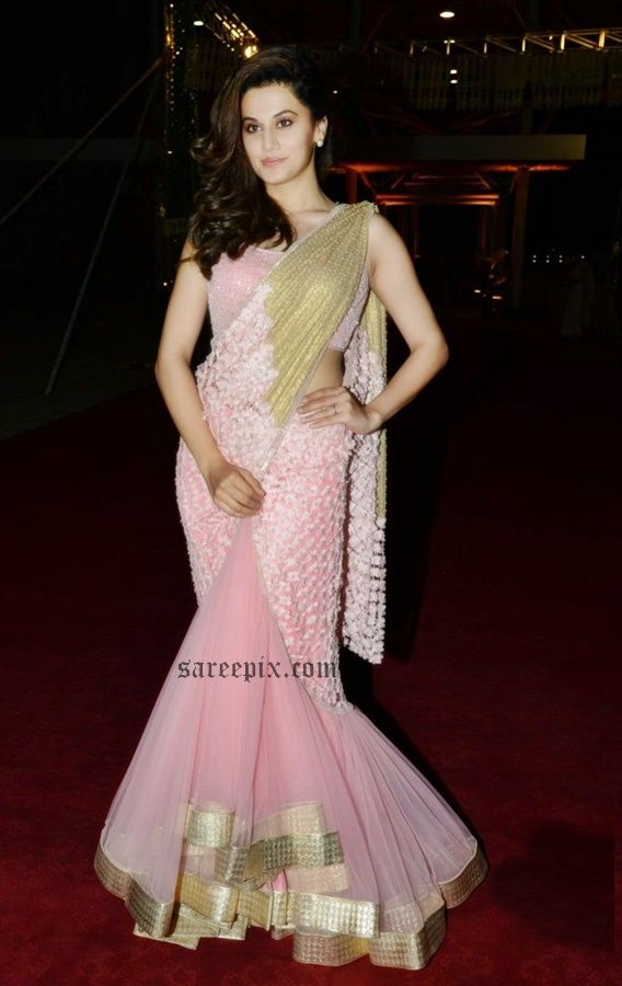 Actress Tapsee in half and half saree at PVP's daughter half saree function. The 28-year old beauty graced the event in Rabani and Rakha designed lehenga s