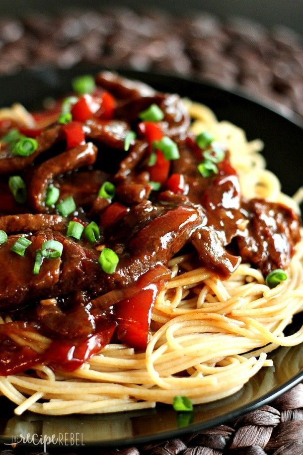 Slow Cooker Mongolian Beef: Tender beef cooks in a rich, dark, sweet and sour sauce in the crock pot -- the perfect easy meal for weeknights! http://www.thereciperebel.com