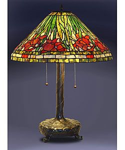 @Overstock - Daffodil Tiffany Style Table Lamp - Elegant Daffodil table lamp has been handcrafted using methods first developed by Louis Comfort TiffanyLighting has an intricate stained glass design and elegant bronze tone hardwareLamp is a unique addition to any home decor  http://www.overstock.com/Home-Garden/Daffodil-Tiffany-Style-Table-Lamp/2549291/product.html?CID=214117 $131.99
