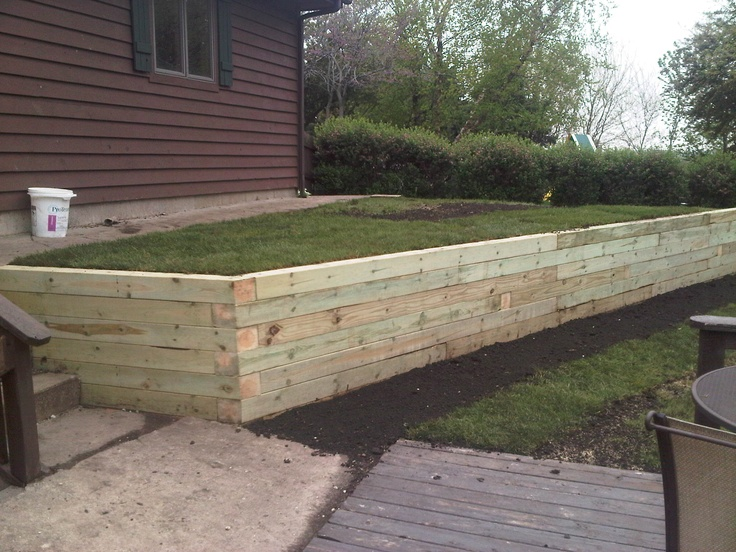A Timber Retaining Wall cleans up the place nice.