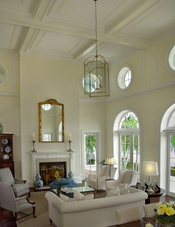 Elegant White Living Room With High Ceiling And Arched