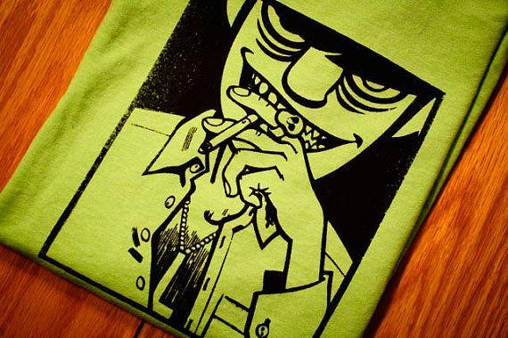 He encontrado este interesante anuncio de Etsy en https://www.etsy.com/es/listing/89714611/murdoc-gorillaz-screenprinted-t-shirt