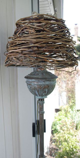 Wrap grapevines around metal lamp frame to make outdoor lamp shade!