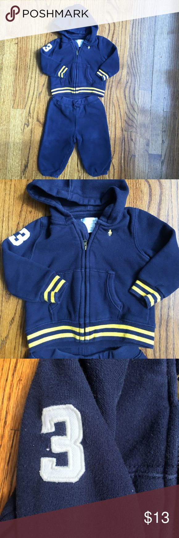 Polo Ralph Lauren baby boy sweat suit Polo Ralph Lauren baby boy sweat suit. Set includes sweat pants and a full zip hoodie. Navy with bright yellow stripe on sleeve cuff and waist band ( sweat shirt only). A white #3 is on the right sleeve. Gently used and lots of life left. size 6-9 months. Polo by Ralph Lauren Matching Sets