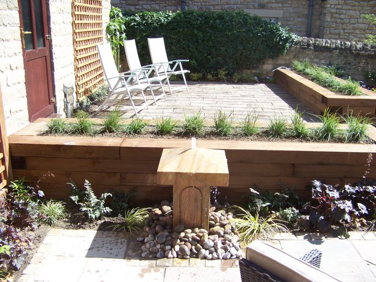 Finished Garden with water feature sleeper raised beds and sandstone paving.