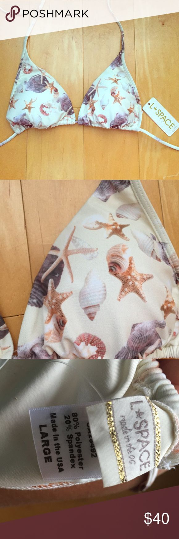 NWT Lspace seashell bikini top Perfect for all those real mermaids  NWT L*space seashell bikini top size large. Super cute!! Hate to get rid of this one but I have to many bikinis~ l*space Swim Bikinis