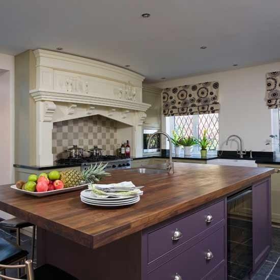 painted purple cabinets, dark butcher block island