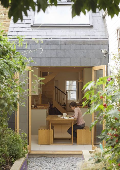 London studio alma-nac staggered the floors of this extension to a 2.3 metre-wide terraced house in south London to help bring natural light in through a sloping roof.