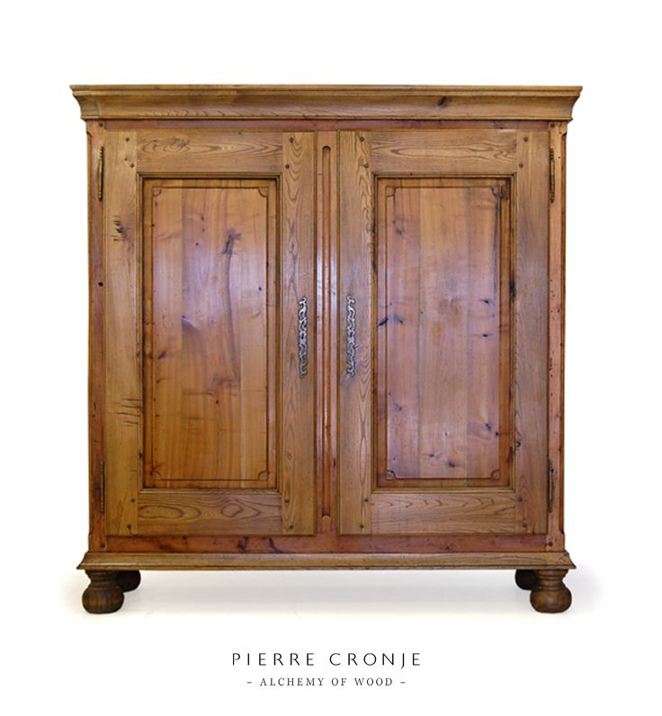 A Pierre Cronje Cape Cupboard with bun feet. Very popular as a stand-alone kitchen cupboard, great for a farm style room.