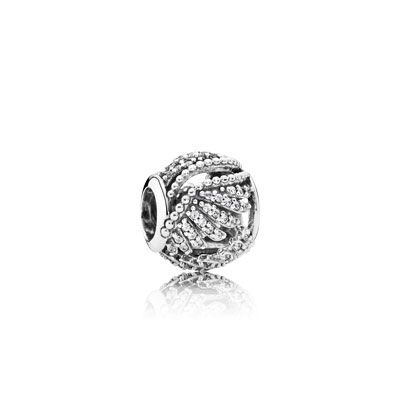 The majestic wings of the mythical phoenix wrap beautifully around this delicate openwork charm in sterling silver, adorned with multiple micro-set sparkling stones. The perfect starter piece for a phoenix feather jewelry story. #PANDORA #PANDORAcharm