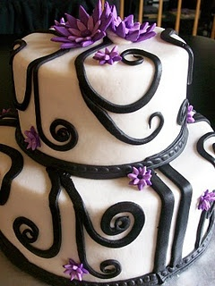 black and white cake with purple flowers