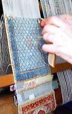 silk miniature weaving - this lady sells hand-knotted silk miniature carpets