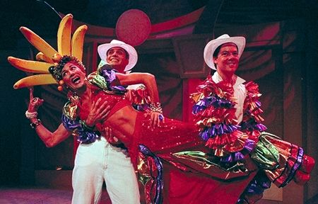 Jeff Griggs (L) and David Barnathan support Clay Adkins as Carmen Miranda at the Stella Adler Theatre, directed by Rick Sparks