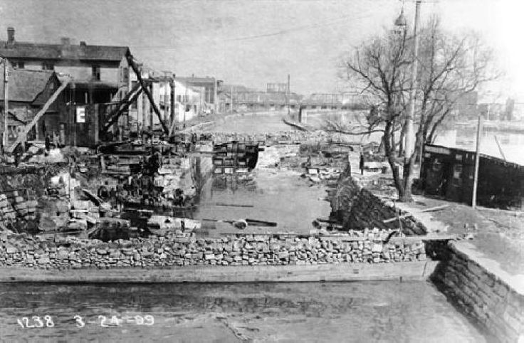 """Removal of Guard Lock 3/04/1899.  From host site: """"The guard lock protected the canal southward from river flooding. The canal north of here to Lock 5 was originally in a pool of the river formed by a dam to the right at Jefferson St. As part of the changes for the Sanitary and Ship Canal, a wall was built between the canal and the Desplaines River to the right to a point north of Lock 5, eliminating the need for this guard lock."""