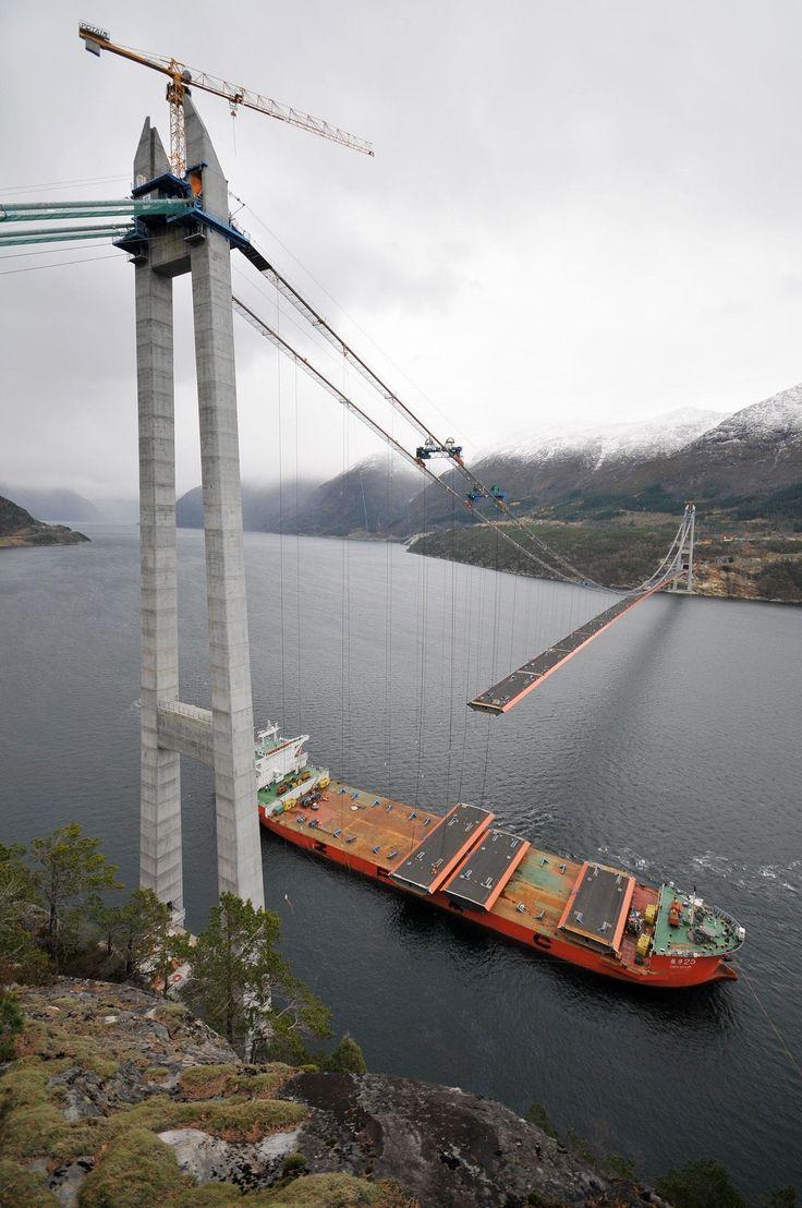 Hardanger Bridge (Norways Sky Bridge) the Roadbed is being hoisted in place