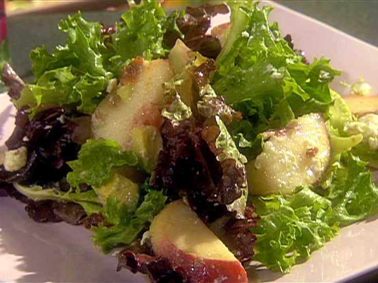 Mixed Green Salad with Diced Avocado, Peaches, Crispy Bacon, Feta Cheese and Champagne Vinaigrette recipe from The Essence of Emeril via Food Network
