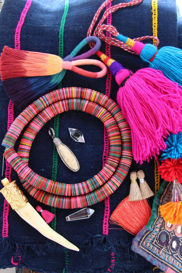 The good stuff // Tribal textiles, beads, pom poms, tassels, and camel swag all from WomanShopsWorld on etsy
