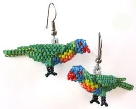 3D peyote Rainbow Lorikeet   Lightweight earrings that capture the cheeky character of these beautiful Lorikeets.  I designed this bird for a friend who has a pet Rainbow Lorikeet. During the process, I discovered how easy and effective it is to make fully sculpted animals using peyote stitch.