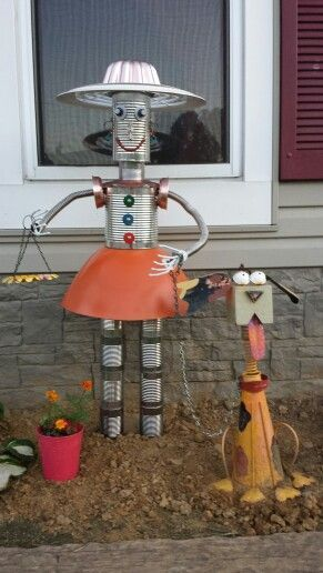 Latest creation. Lady made of scrap metal and recyclables. Dog was purchased. Just added some cuteness to her.: