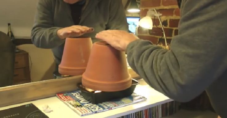 using a tea light and flower pot to help heat your home