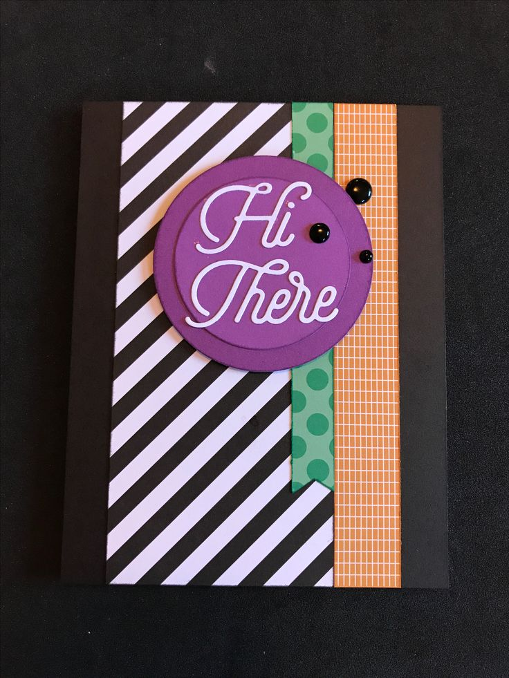 "This weeks Color Dare of Emerald, Goldrush, Pansy, Black & White brought out the new Cats & Bats paper pack. The new ""HI THERE"" thin cuts along with the circle thin cuts & black dots all combine to make this card using a new card layout from WYW Merriest Wishes cardmaking kit."