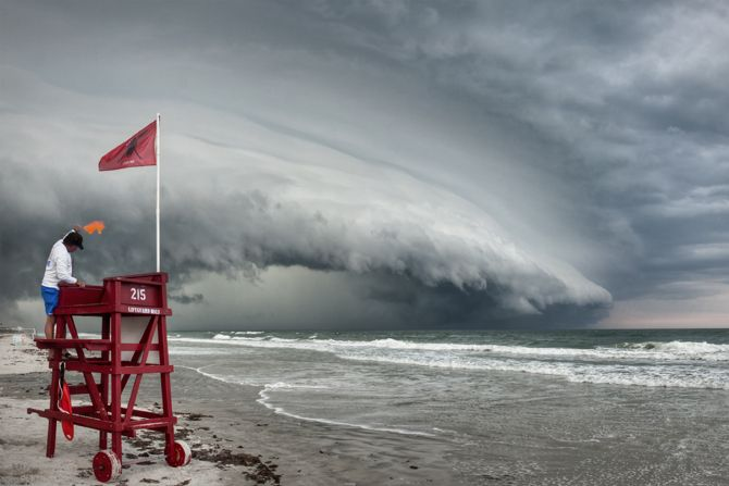 A large shelf cloud formation approaches Ormand Beach, Florida. (A shelf cloud is a low, horizontal, wedge-shaped arcus cloud -it's attached to the base of the parent cloud, which is usually a thunderstorm, but could form on any type of convective cloud.) Photo by Jason Weingart