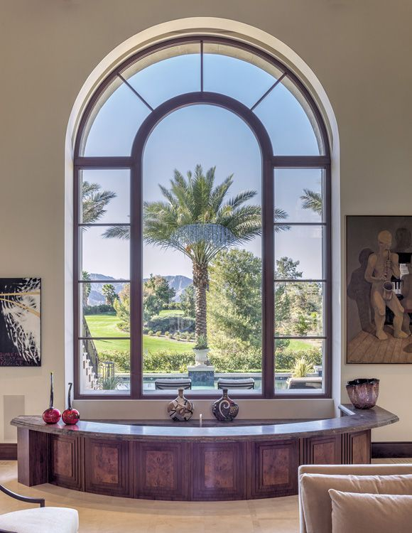 Huge arched window with simulated divided lights for a magnificent villa in California