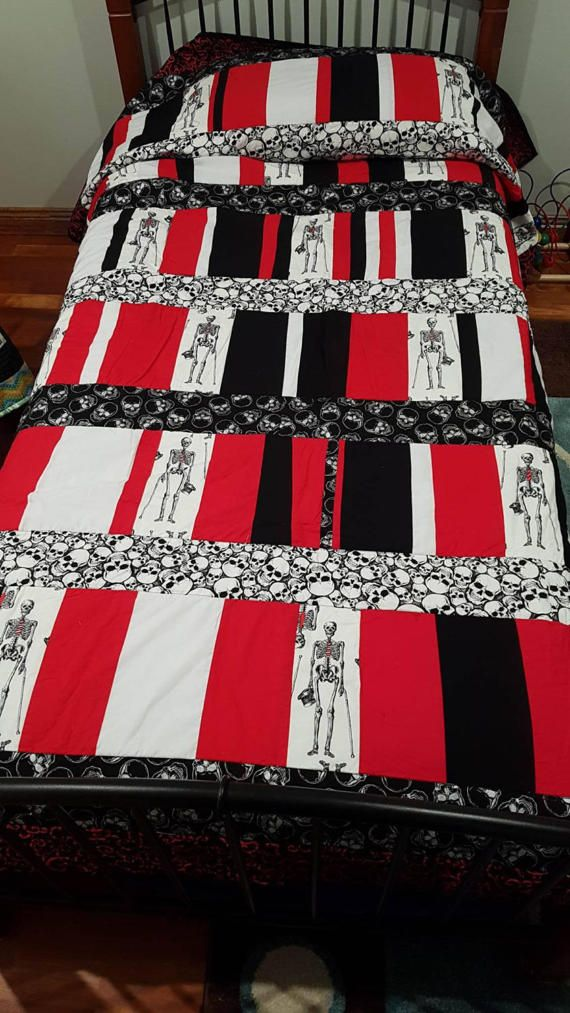 What a stunner of a quilt. Classic red black and white. Perfect for those who love skulls, gothic, or love something different. This is a single bed with pillow cover, extra long , hangover the sides. photo is on a single bed. Can be also used for a double bed topper ( no over hang) Excellent quality quilting cotton , polyester batting. Perfect for summer or winter. Ready to post . Machine washable , line dry, no bleach products.  If you would like a quilt made to suit your personality…