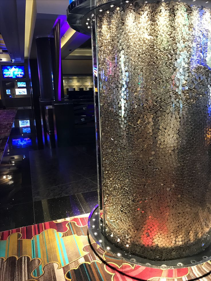 Photo 5: Coin filled column in Crown. This cash filled column is definitely well suited for a casino, it's really only there so make a statement. MONEY! It is a very creative way to continue the theme of glitz and over the top decor with the idea of money.