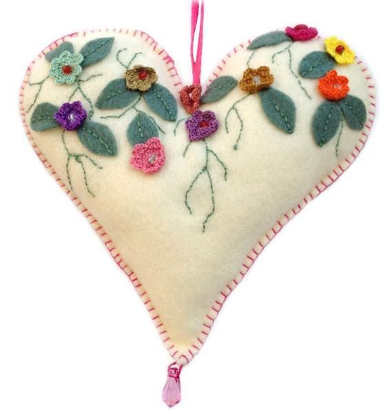 "Felt heart decorated with most delicate crochet flowers pink details. Hanging decor stuffed it with a polyester fiber fill. The heart measures 7"" wide and only #feltflowers"