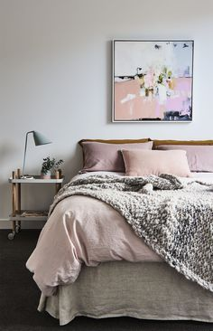 Dusty rose bedroom, with cozy chunky knit throw. Love the abstract art piece above the bed and the copper accents.  | Blush, Bedrooms and Rose Bedro…