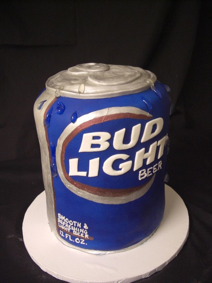 Bud Light Can Grooms Cake 5 or 6 (I can't remember) 8 inch cakes stacked with boards in between for easier serving. Bud Light can...