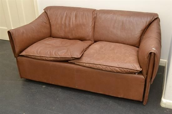 A DANISH DISTRESSED LEATHER FOLD OVER COUCH $240