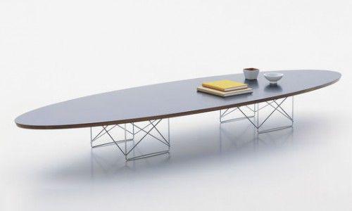 """Elliptical Table, ETR """"Surfebrettet"""" På grunn av sin likhet med et surfebrett, fikk det lave elliptiske salongbord ETR (Elliptical Table Rod Base) raskt overtatt kallenavnet «surfebrett bordet""""."""
