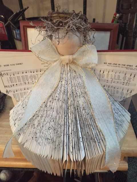 Vintage Hymnals transformed into beautiful angels. Different colored ribbon can be selected. Special Hymns can be selected and used as the wing
