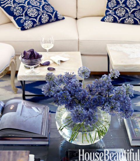 Placed in a clear glass vase, alliums accentuate the blue in this Robert Couturier-designed living room in a vacation house in Florida. Click through for more easy-to-make flower arrangements.