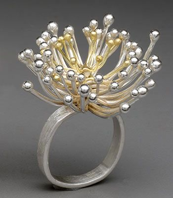 "Paulette J. Werger: Ring in sterling silver and 18k gold. Size 7. Measures approx. 1.25 x 1.25 x 1.25"" Pods and flowers are articulated, move, and wiggle when worn."