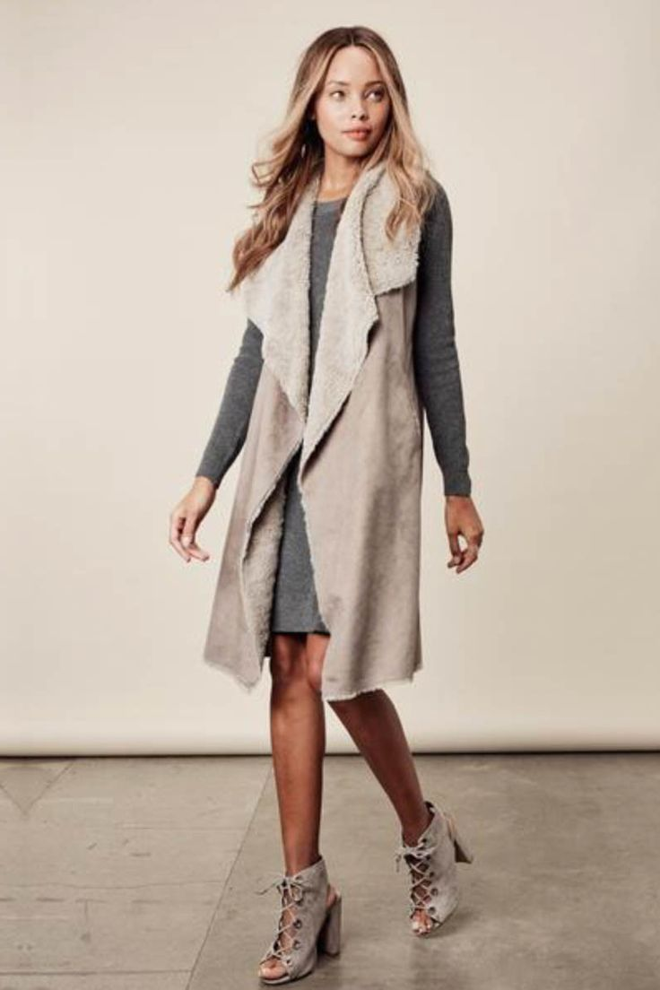 Luxuriously soft faux shearling vest in a two tone color accent. Comfy and chic. Content + Care: 100% Polyester Hand Wash