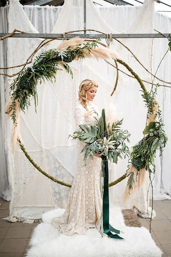 Wedding wreaths are the new ceremony arch in 2018.