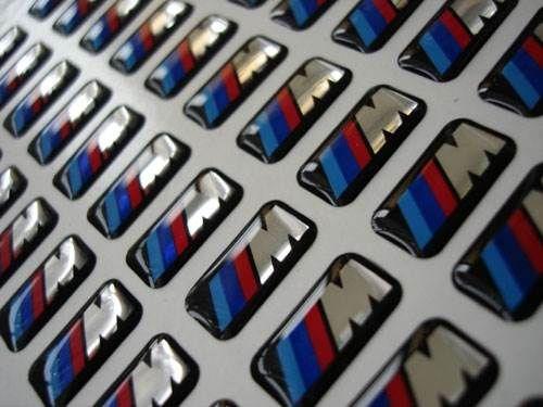 Эмблемы - Наклейки объёмные шильдики 17 х 9 мм., BMW М Style, на диски, для панели приборов и др., маленькие, прямоугольные, комплект 4 шт.